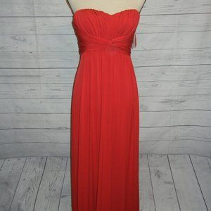 Red strapless formal gown